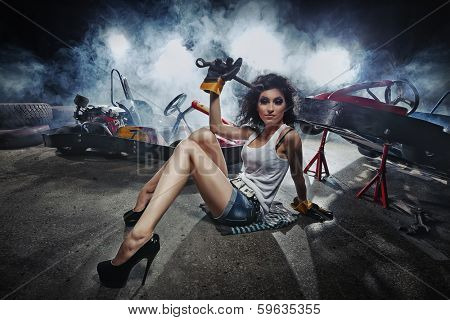 Girl at a garage next to the Go-kart  in smoke