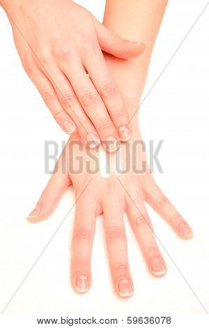 woman moisturizing hands