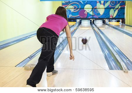 Person In Bowling Center Throws The Ball On Lane