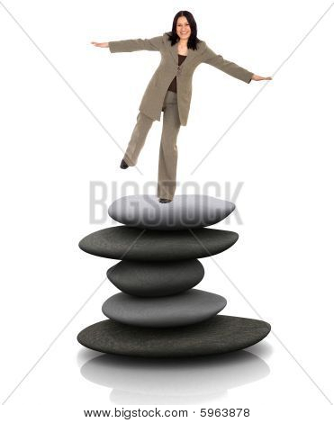 Business Woman Balancing Over Stones