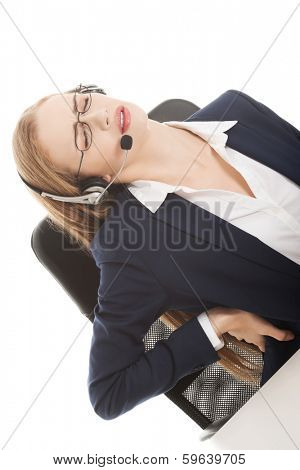 Beautiful business woman at call center is having back ache. Isolated on white.