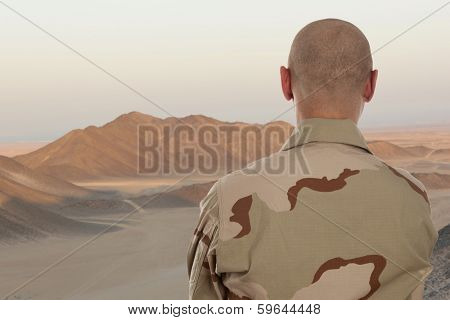 Soldier amid the mountains of Afghanistan