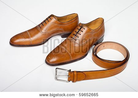 men's dress shoes with belt on white background