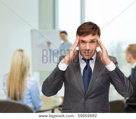 business and office, stress, problem, crisis concept - stressed buisnessman or teacher having headache at office