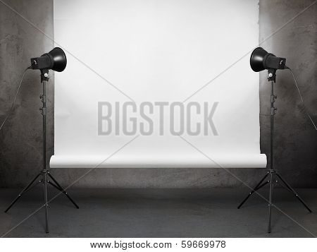 photo studio in old grunge room with concrete wall and paper background