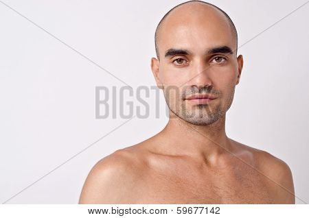 Bald Caucasian handsome man with topless shoulders.