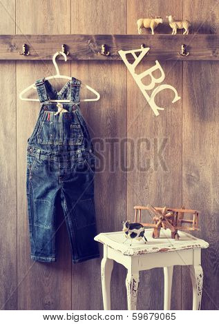 Nursery with toy plane and animal figures with hanging dungarees