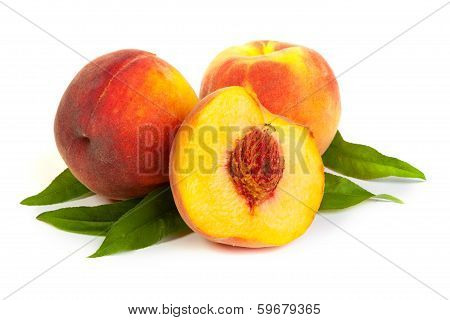Three Perfect, Ripe Peaches With A Half  And Slices Isolated On A White Background.