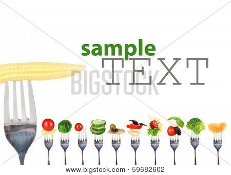 Different food on forks isolated on white
