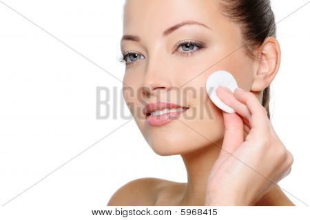 Beauty Woman Cleaning Her Health Face With Cotton Swab