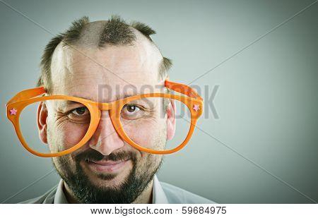 Portrait of a half bald man