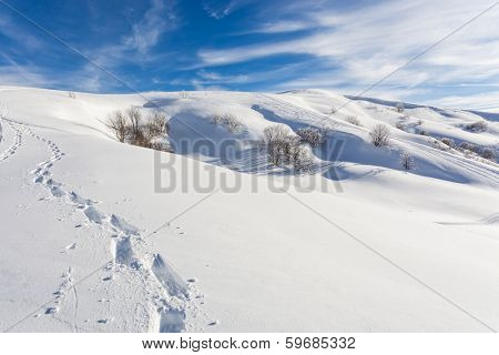 Scenic sunny snowy mountain landscape ideal environment to go trekking with snowshoes