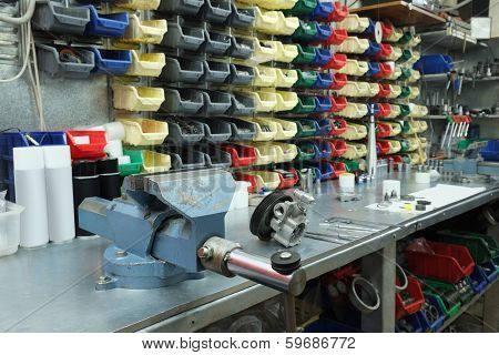 the image of a vice on a metal workbench