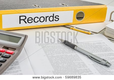 A yellow folder with the label Records
