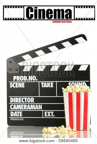 Movie clapperboard and popcorn isolated on white