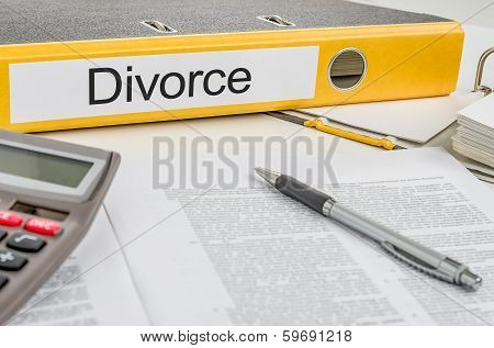 A yellow folder with the label  Divorce