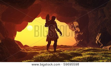 Silhouette of prehistoric man in the cave.