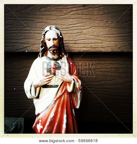 weathered statue of Jesus in the instagram style