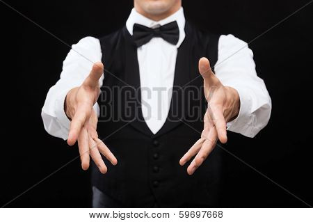 magic, performance, circus, casino and show concept - casino dealer showing trick