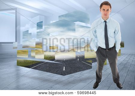 Serious businessman standing with hands in pockets against room with holographic cloud