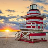 stock photo of lifeguard  - Miami South Beach sunrise with famous lifeguard tower - JPG