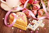 stock photo of scrabble  - love words made of scrabble letters dried roses and heart shaped cookies with sprinkles for valentine on wooden table - JPG