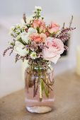 stock photo of masonic  - mason jar of roses - JPG