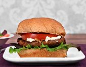 foto of portobello mushroom  - Close up of a portobello mushroom burger on a whole wheat bun - JPG