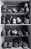 stock photo of hackney  - An old wooden shoes box with a lot of different footwear inside - JPG