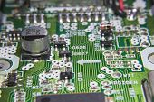picture of capacitor  - Macro of a Circuit board with chips and capacitor - JPG