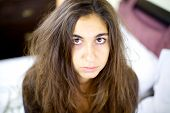 foto of split ends  - Woman with really bad hair day and no sleep feeling angry - JPG