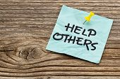 foto of helping others  - help others  reminder note against grained weathered wood - JPG