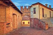 Narrow cobbled street in old historic center of Monticello D'Alba - small town in Piedmont, Northern
