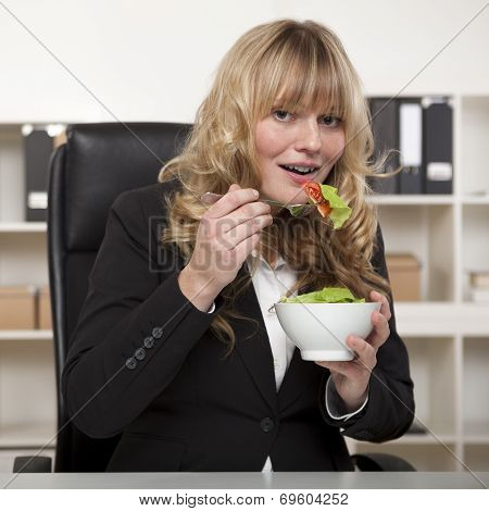 Smiling Businesswoman Enjoying A Healthy Salad