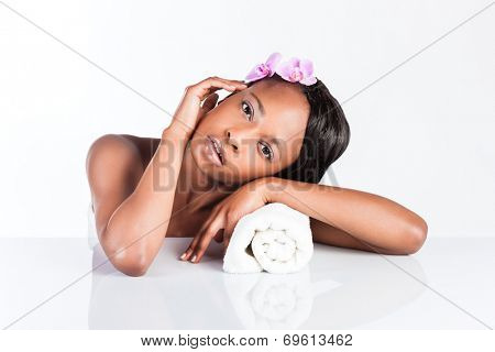 Young African woman in Studio doing body care with towel taking bath for young and beautiful skin and relaxation