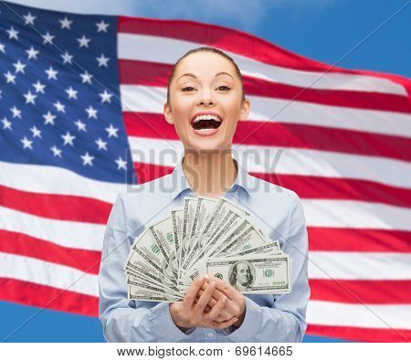 business, holidays and people concept - laughing businesswoman with dollar cash money over american flag background