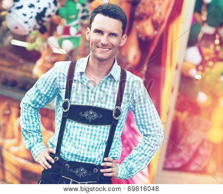 Young man posing in traditional Bavarian Lederhosen