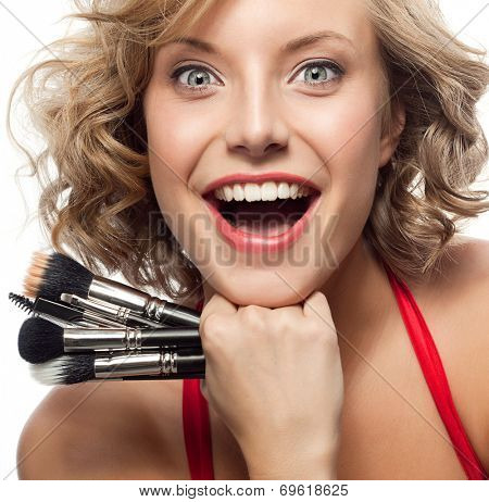 closeup portrait of attractive  caucasian smiling woman blond isolated on white studio shot lips toothy smile face hair head and shoulders looking at camera blue eyes tooth brush makeup