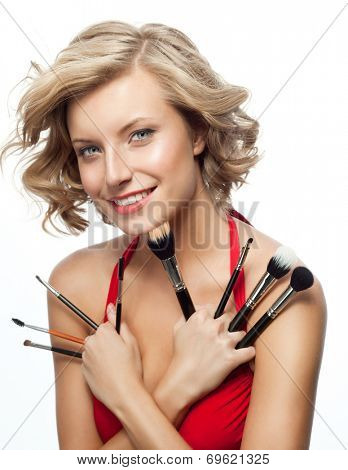 closeup portrait of attractive  caucasian smiling woman blond isolated on white studio shot lips toothy smile face hair head and shoulders looking at camera blue eyes tooth brushes makeup
