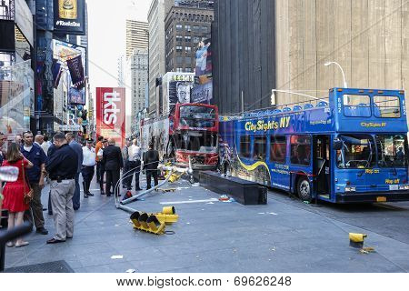 Downed streetlight, TKTS booth & buses