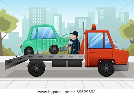 Tow Truck Towing A Broken Down Car