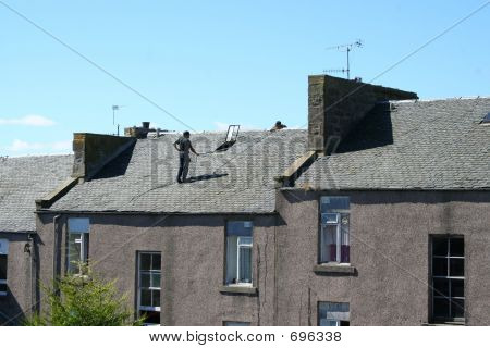 Men Working On Slate Roof