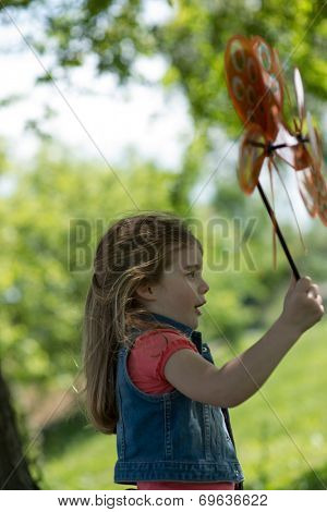 Little girl playing with pinwheel