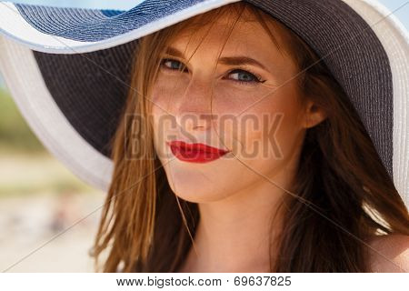 Beauty, summer. Cute, attractive woman on the beach