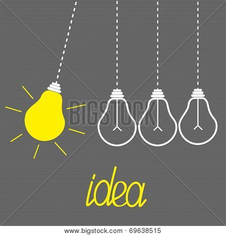Hanging Yellow Light Bulbs. Perpetual Motion. Idea Concept. Grey Background.