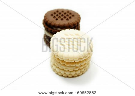 Vanilla Cookies Stacked In Front Of Chocolate Cookies