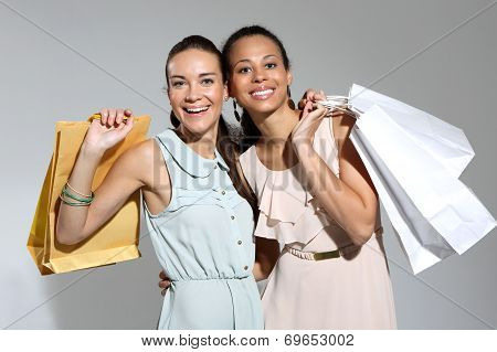 I love shopping! Women with shopping bags