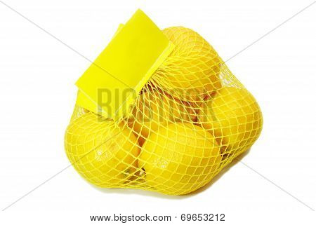 Multiple Organic Lemons Purchased In A Net Bag