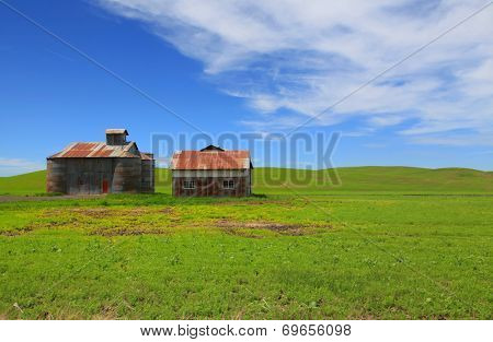 Abandoned barns in rolling hills of Palouse