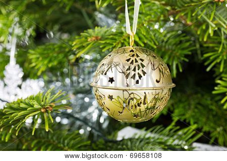 Gold Christmas Bauble Hanging On A Christmas Tree
